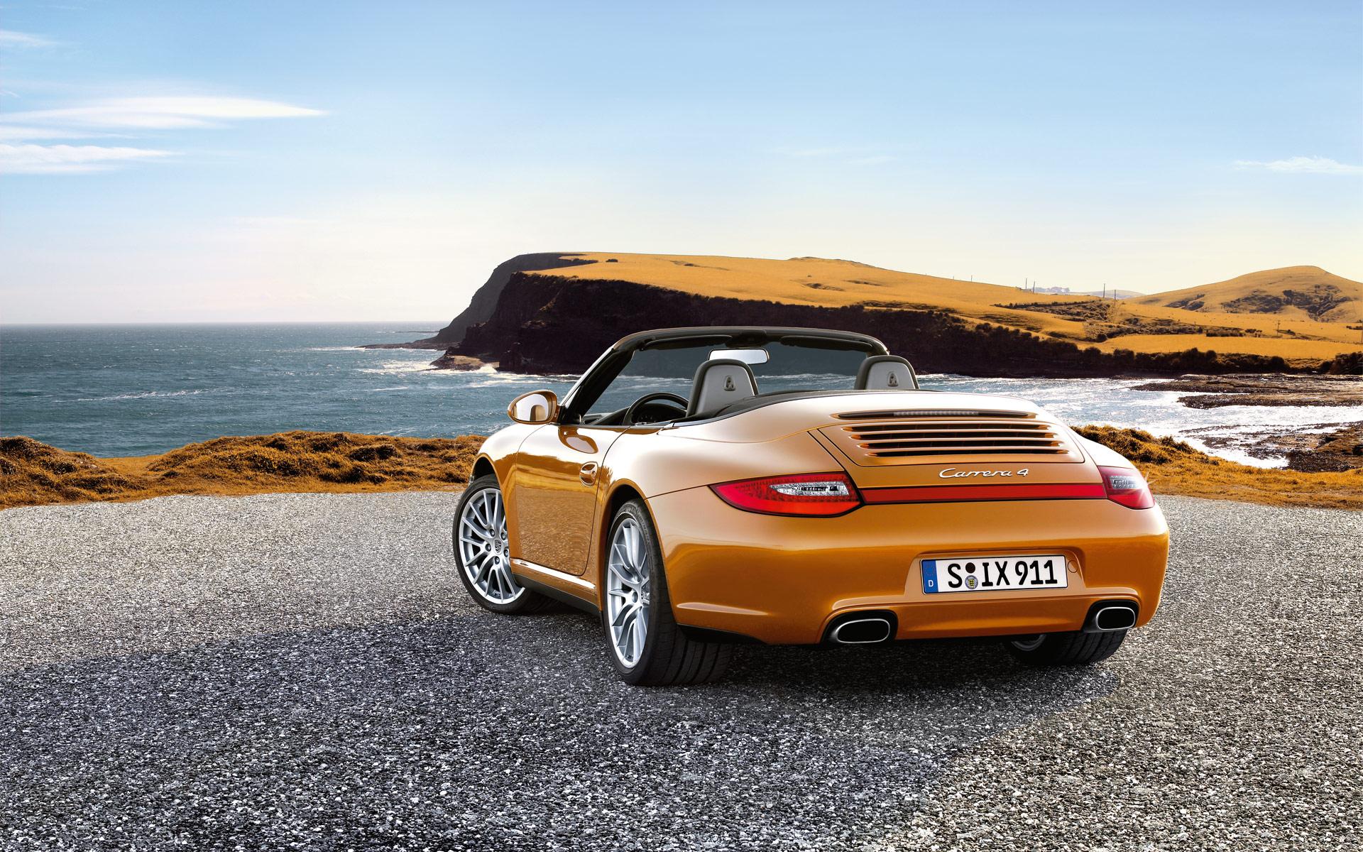Оранжевый автомобиль porsche carrera  № 837075 бесплатно