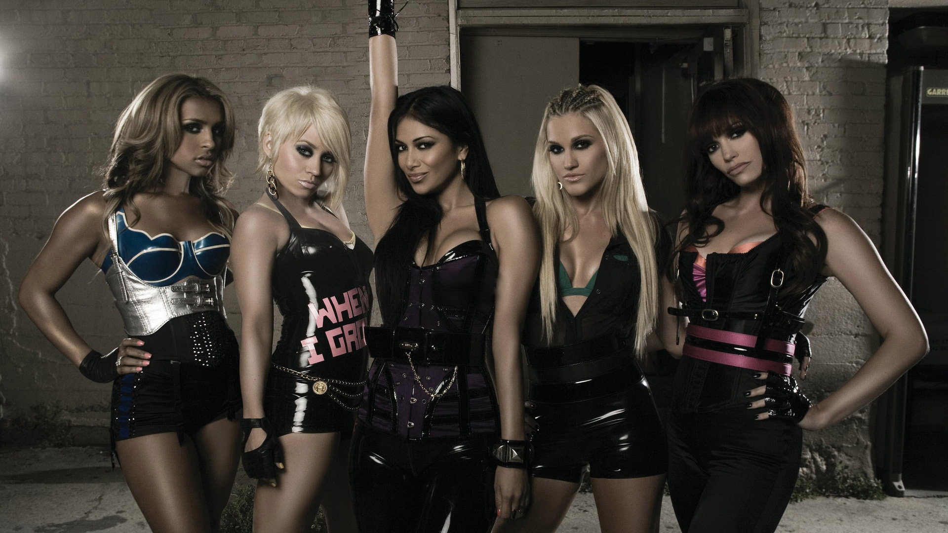 The pussycat dolls get soaking wet in pvc bodysuits in hot new photo teaser